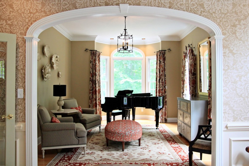 In a playful touch arched windows call for special drapery treatments